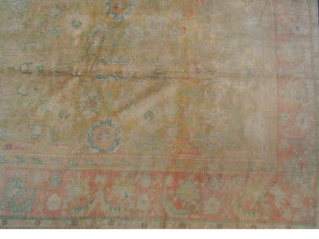 An Oushak carpet West Anatolia, size approximately 9ft. x 11ft. 8in.