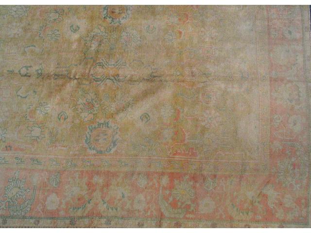 An Oushak carpet West Anatolia, size approximately 9ft. x 11ft. 8in.