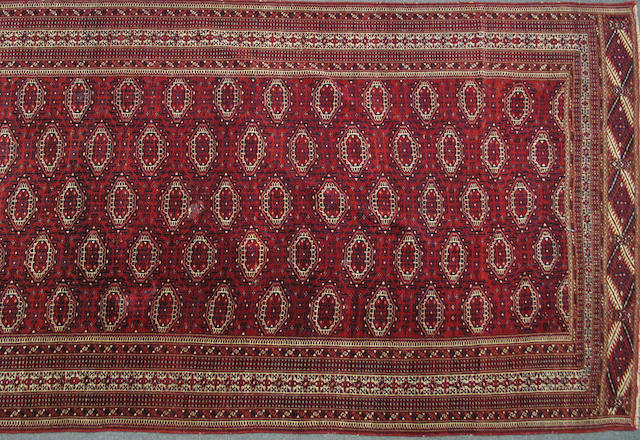 A Turkoman carpet96 Turkestan, size approximately 7ft. 2in. x 12ft. 4in.