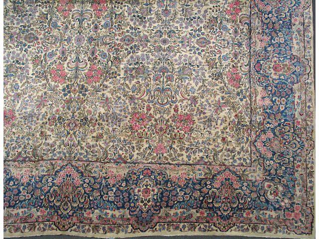 A Kerman carpet size approximately 14ft. 5in. x 20ft. 5in.