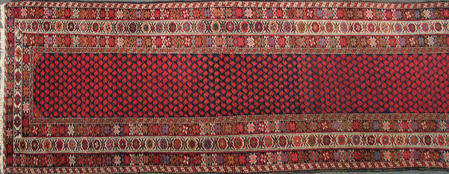 A Malayer carpet size approximately 2ft. 11in. x 12ft. 10in.