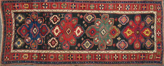 A Kurdish runner Northwest Persia, size approximately 3ft. 9in. x 9ft. 2in.