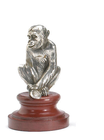 A fine monkey who is considering his face in a mirror, by Payen, French circa 1920,