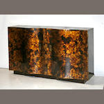 A contemporary faux tortoiseshell finish serpentine front two door finish side cabinet, circa 1950s