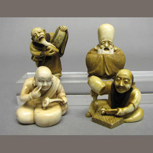 A group of four Japanese style tinted ivory netsuke 20th Century