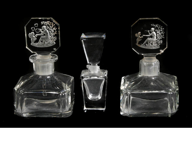 A group of four glass scent bottles and stoppers