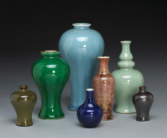 A group of monochrome glazed porcelain vases and miniature vases