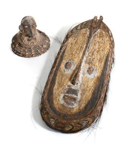 A group of three New Guinea masks