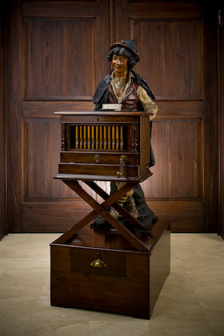 A Polyphon Savoyard coin-operated disc music box automaton, Circa 1900, Style 100 playing 11.1/4-inch disks, 'The Organ-Grinder',