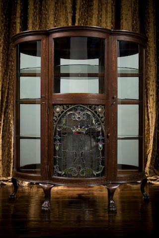 An extremely rare 15.1/2-inch Regina auto-change disk music box china cabinet, Circa 1906, Style 335, one of only eleven thought to have been manufactured,