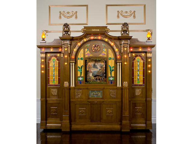 A very fine and unique Hupfeld Helios Model III/39 Orchestrion, Early 1910s, The Classical Case model, with illuminated automaton scene,