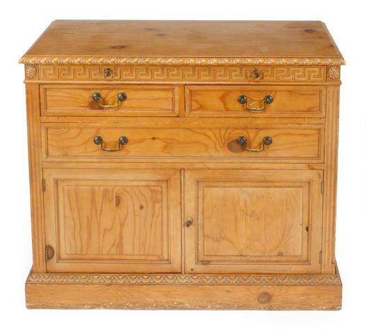 A George III style carved pine chest
