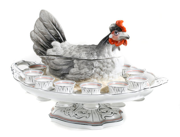 A Continental glazed eathenware egg server in the form of a hen