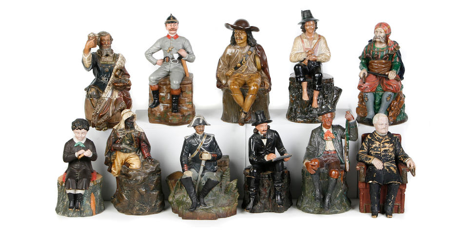 A group of eleven Continental glazed earthenware figural tobacco jars