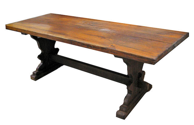 A Continental Baroque style oak trestle table