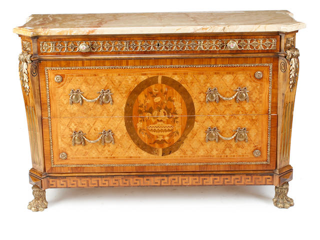 A pair of Louis XVI style gilt metal mounted marquetry commodes