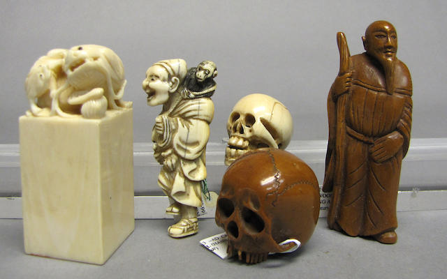 Five ivory and boxwood figural netsuke