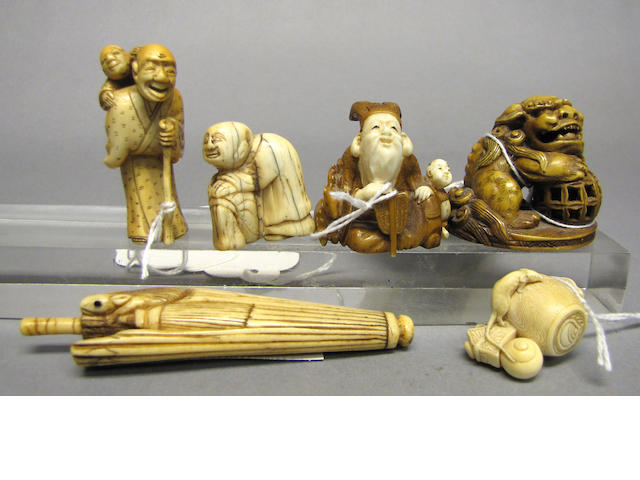 A group of eight ivory and stag antler netsuke
