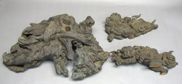 A group of four carved wood architectural fragments and two rootwood stands