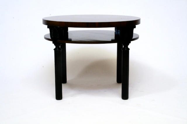 A Swedish palisander veneered and ebonized circular two tiered side table 1940s