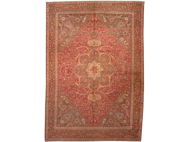 A Tabriz carpet Size approximately 9ft. 4in. x 13ft. 6in.