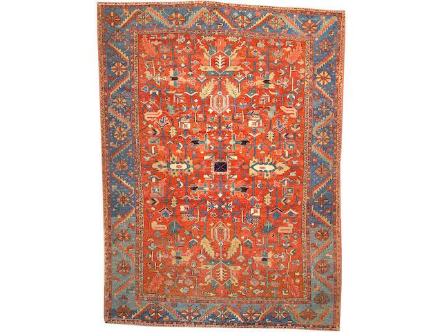 A Heriz carpet Size approximately 8ft. 6in. x 11ft. 7in.