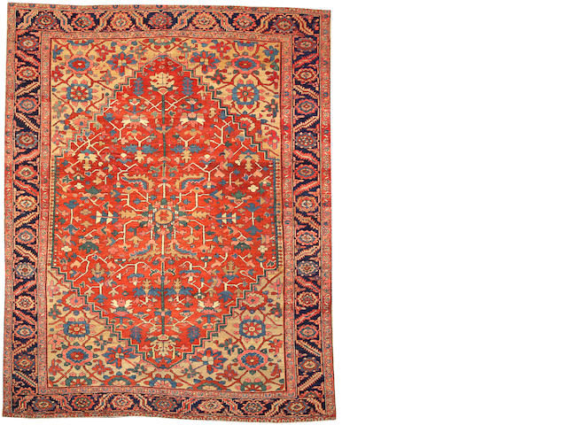 A Heriz carpet Size approximately 9ft. x 11ft. 6in.