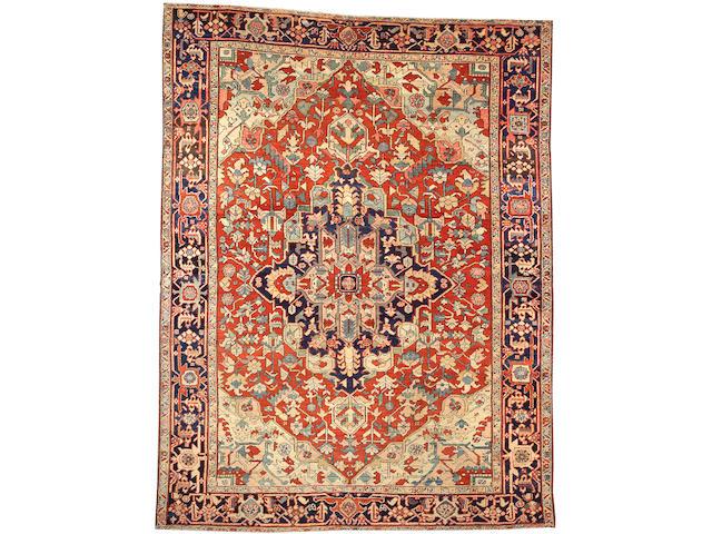 A Heriz carpet Size approximately 8ft. 5in. x 11ft. 1in.