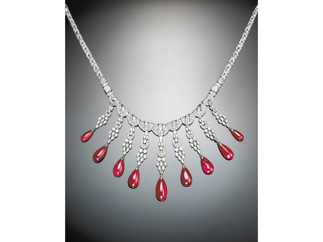 An art deco diamond, ruby and platinum necklace,