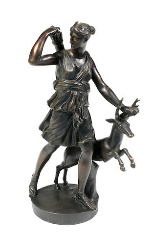 A patinated bronze figural group of Diana with a deer