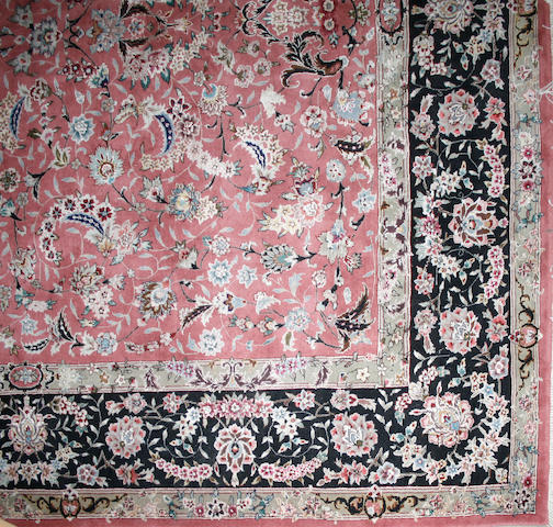 A Tabriz design carpet size approximately 8ft. x 10ft.