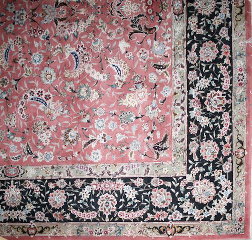 A Tabriz design carpet size approximately 8ft. x 10ft.
