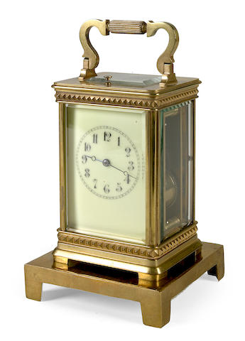 A French gilt brass carriage clock with push repeat mechanism
