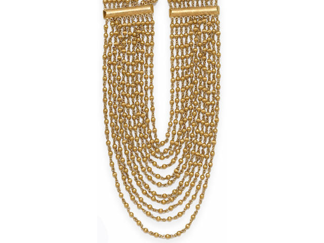 An eighteen karat gold bead multi-strand necklace