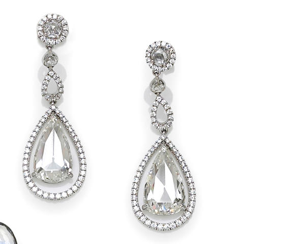 A pair of diamond pendant earrings