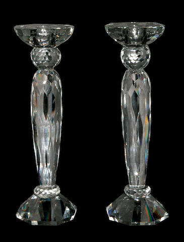 A set of cut glass baluster candlesticks