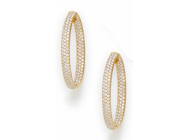 A pair of diamond large hoop earrings