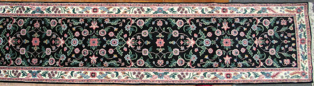 A Pakistani runner size approximately 2ft. 6in. x 20ft.