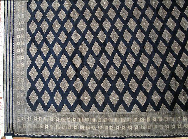 A Pakistani carpet size approximately 9ft. x 12ft.