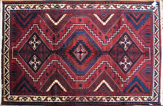 A Shiraz carpet Size approximately 7ft. x 9ft. 7in.