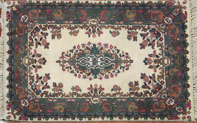 An Indian carpet size approximately 2ft. x 3ft.