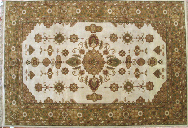 An Indian carpet size approximately 5ft. 10in. x 8ft. 9in.
