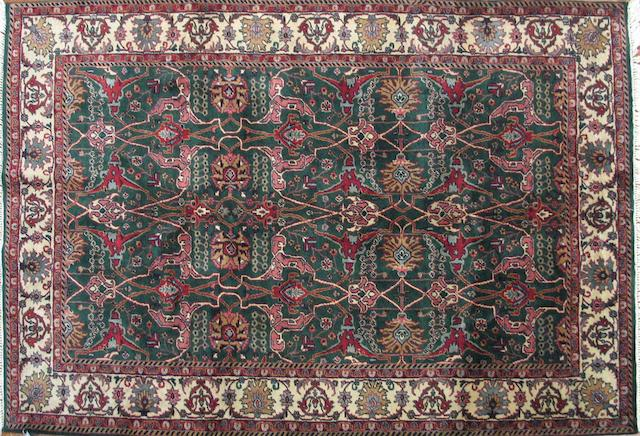 An Indian carpet size approximately 6ft. 1in. x 8ft. 10in.