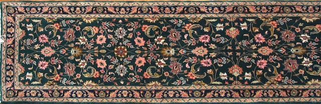 A Tabriz runner size approximately 2ft. 6in. x 13ft.