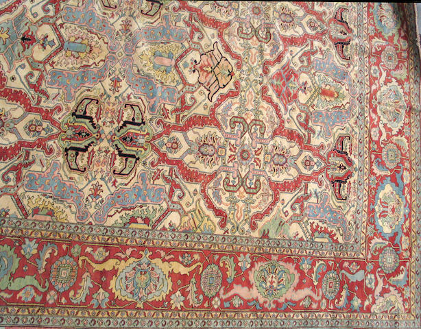 A Heriz design carpet size approximately
