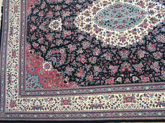 A Chinese carpet size approximately 12ft. x 16ft.
