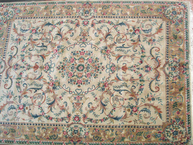 An Indian carpet size approximately 9ft. 11in. x 12ft.