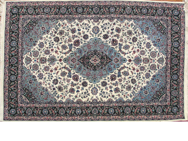 A Pakistani carpet size approximately 6ft. x 9ft.