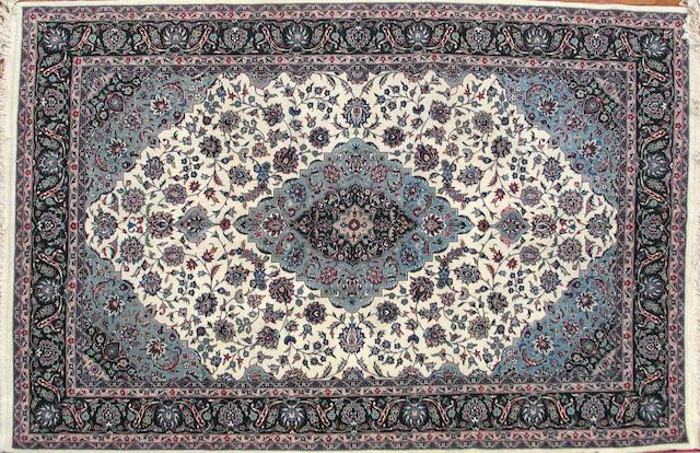 A Pakistani carpet size approximately 6ft. x 9ft.