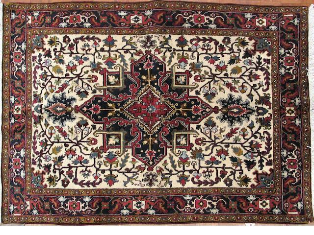 A Heriz carpet size approximately 5ft. 2in. x 7ft. 2in.